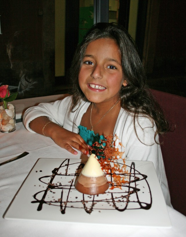 Carolina enjoying her delicious three chocolate mousse dessert!!