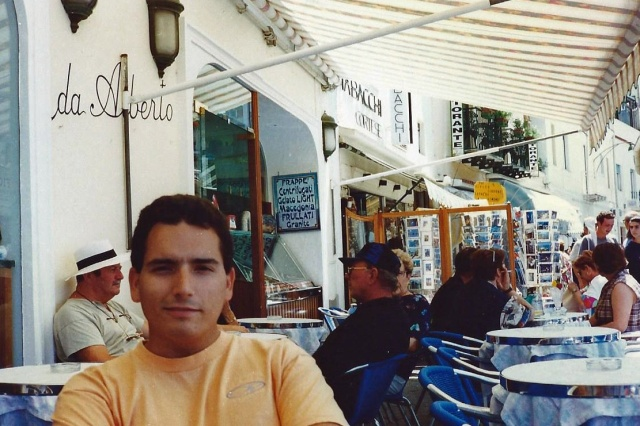 Hubby relaxing in a cafe on the Piazzetta, back in the day on our first trip there!