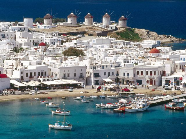 The beautiful Mykonos harbor and the town in the background