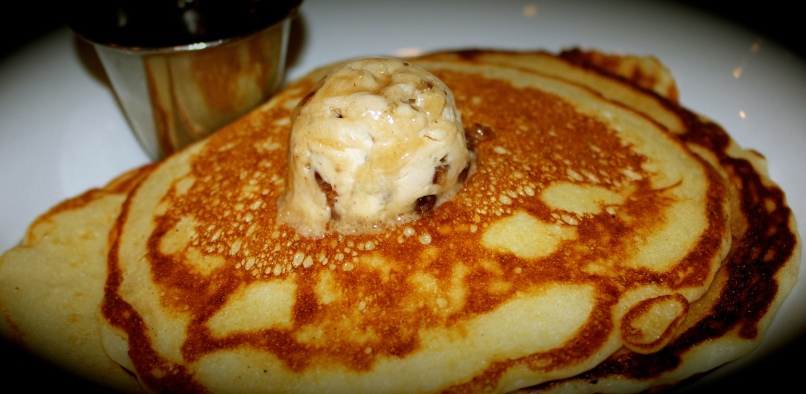 Papa's Buttermilk Pancakes served with  pecan-caramel praline butter and maple syrup
