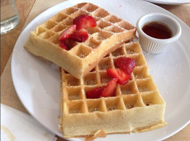 Waffles with strawberries and powdered sugar...
