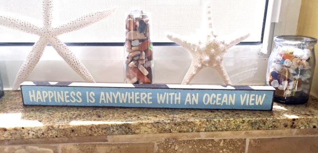 I just had to buy the wooden sign and add it to my beach life collection on my windowsill.