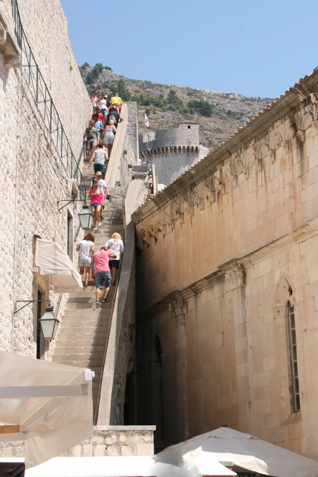The steep stair you must climb to go up to the city walls.
